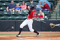 Eric Jenkins (5) of the Hickory Crawdads follows through on his swing against the Delmarva Shorebirds at L.P. Frans Stadium on June 18, 2016 in Hickory, North Carolina.  The Crawdads defeated the Shorebirds 1-0 in game one of a double-header.  (Brian Westerholt/Four Seam Images)