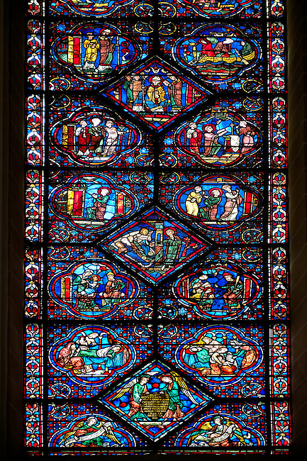Medieval stained glass Window of the Gothic Cathedral of Chartres, France - dedicated to the Life and Miracles of St Nicholas. A UNESCO World Heritage Site.