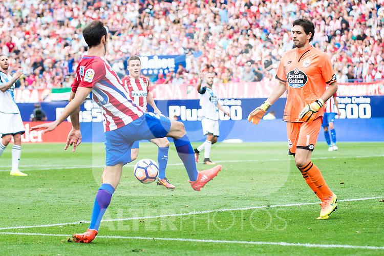 Atletico de Madrid's players Juanfran Torres and Kevin Gameiro and Deportivo de la Coruña's player Poroto Lux during a match of La Liga Santander at Vicente Calderon Stadium in Madrid. September 25, Spain. 2016. (ALTERPHOTOS/BorjaB.Hojas)