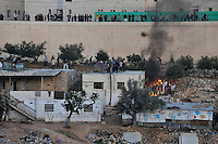 Rioting Jewish settler youths attack a Palestinian house. Violence erupted as the Israeli army evicted a group of settlers from a disputed building in Hebron. The Israeli high court had rejected the settlers' claim that they legally bought the house from its Palestinian owner. As the house became a symbol of defiance, the few families living there were joined by a mob of some 1,500 radical right-wing youths, who went on a rampage and attacked Palestinians in the mixed West Bank city.
