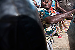 Gender Defender coach Beatrice Nyariara, demonstrates self-defence techniques to other grandmothers in Nairobi's Korogocho slum.