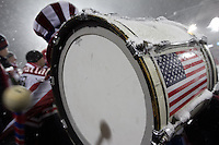 Under a steady snowfall, USA fan beats a drum while watching the USA Men's National Team's World Cup Qualifier against Costa Rica  at Dick's Sporting Good Park in Commerce City, CO on March 22, 2013.