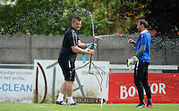 20150627 - Lauwe , BELGIUM : Kortrijk's goalkeeper coach Cedric Berthelin (left) pictured with Kortrijk's Darren Keet during a friendly match between Belgian first division team KV Kortrijk and Belgian third division soccer team FC Izegem , during the preparations for the 2015-2016 season, Saturday 27th June 2015 in Lauwe. PHOTO DAVID CATRY