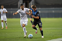 SAN JOSE, CA - OCTOBER 03: Carlos Fiero #21 of the San Jose Earthquakes and Sebastian Lletget #17 battle for the ball during a game between Los Angeles Galaxy and San Jose Earthquakes at Earthquakes Stadium on October 03, 2020 in San Jose, California.