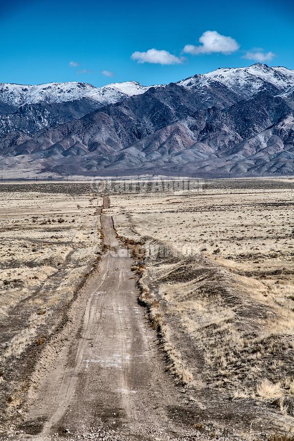 A dirt road crosses the desert toward the West Humboldt Range near Oreana, Nevada