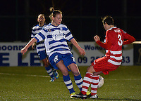 20140221 - OOSTAKKER , BELGIUM : Gent Margaux Van Ackere (l) pictured with Antwerp Charlotte Andries (r) during the soccer match between the women teams of AA Gent Ladies  and RAFC Antwerp Ladies , on the 19th matchday of the BeNeleague competition Friday 21 February 2014 in Oostakker. PHOTO DAVID CATRY