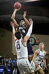 SIOUX FALLS, SD - MARCH 8: Kevin Obanor #0 of the Oral Roberts Golden Eagles shoots over Luke Appel #13 of the South Dakota State Jackrabbits during the Summit League Basketball Tournament at the Sanford Pentagon in Sioux Falls, SD. (Photo by Dave Eggen/Inertia)