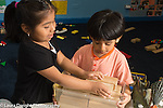 Education preschool 3-4 year olds boy and girl playing together
