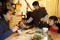 CHINA. Beijing. The He family, at home. He Yiran (at center), 1, is the second child in the family. In wake of the approaching census, family's are having trouble registering their second child in the one-child state. 2010