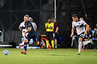 LAKE BUENA VISTA, FL - JULY 26: Johnny Russel of Sporting KC cuts inside and away from Jake Nerwinski of Vancouver Whitecaps FC during a game between Vancouver Whitecaps and Sporting Kansas City at ESPN Wide World of Sports on July 26, 2020 in Lake Buena Vista, Florida.