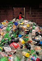 A worker sorts plastic bottles at a recycling plant in Baltimore, Maryland