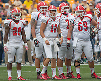 Members of the Youngstown State offense look for the call. Shown are Martin Ruiz (29), quarterback Ricky Davis (12), quarterback Tanner Garry (7) and center Cole Newsome (69).The Pitt Panthers football team defeated the Youngstown State Penguins 45-37 on Saturday, September 5, 2015 at Heinz Field, Pittsburgh, Pennsylvania.