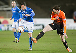 Dundee United v St Johnstone...12.03.14    SPFL<br /> Gary Miller is tackled by Andrew Robertson<br /> Picture by Graeme Hart.<br /> Copyright Perthshire Picture Agency<br /> Tel: 01738 623350  Mobile: 07990 594431