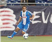 Philadelphia Union midfielder Danny Cruz (44) looks to cross.In a Major League Soccer (MLS) match, the New England Revolution (blue/red) defeated Philadelphia Union (blue/white), 2-0, at Gillette Stadium on April 27, 2013.