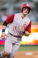 Andrew Knizner (11) of the North Carolina State Wolfpack rounds third base during the game against the Charlotte 49ers at BB&T Ballpark on March 31, 2015 in Charlotte, North Carolina.  The Wolfpack defeated the 49ers 10-6.  (Brian Westerholt/Four Seam Images)