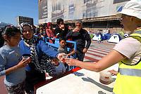 Pireus / Athens 30/3/2016<br /> Refugee camp in Pireus Port. Food distribution organized by volunteers.<br /> Photo Livio Senigalliesi
