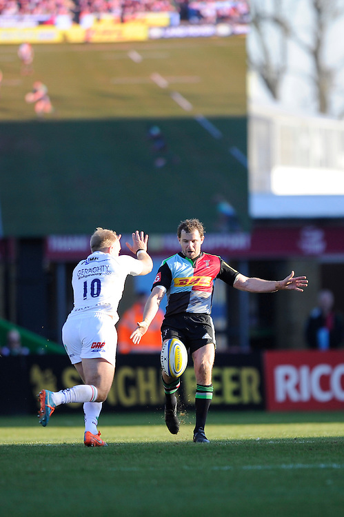 Nick Evans of Harlequins has his chip charged down by Shane Geraghty of London Irish during the Aviva Premiership Rugby match between Harlequins and London Irish at The Twickenham Stoop on Saturday 7th March 2015 (Photo by Rob Munro)