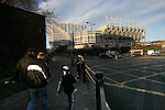 Newcastle United 2 Watford 1, 16/12/2006. St James Park, Premier League. Newcastle United take on Watford (yellow shirts) in a Premiership match at St. James' Park, Newcastle. Both teams were struggling near the bottom of the table with the newly-promoted visitors occupying one of the three relegation at the time of the match. Newcastle won by 2 goals to 1, both being scored by Obafemi Martins. Hameur Bouazza had equalised before United's late winner. Photo shows the exterior to St. James Park which is the city centre with United fans making their way to the game. Photo by Colin McPherson.
