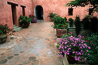 Beautiful colors of Mexico Architecture stucco with flowers and arches in Oaxaca Mexico.