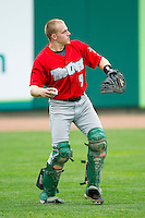 Fort Wayne TinCaps catcher Dane Phillips (9) warms up in the outfield prior to the game against the Lansing Lugnuts at Cooley Law School Stadium on June 5, 2013 in Lansing, Michigan.  The TinCaps defeated the Lugnuts 8-5.  (Brian Westerholt/Four Seam Images)