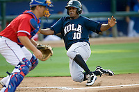 New Orleans Zephyrs shortstop Osvaldo Martinez #10 slides safely at home during a game against the Round Rock Express at the Dell Diamond on July 20, 2011 in Round Rock, Texas.  New Orleans defeated Round Rock 14-11.  (Andrew Woolley/Four Seam Images)