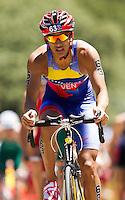 02 JUN 2013 - MADRID, ESP - Luis Miguel Velasquez (VEN) of Venezuela on the bike during the men's ITU 2013 World Triathlon Series round in Casa de Campo, Madrid, Spain <br /> (PHOTO (C) 2013 NIGEL FARROW)