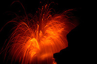 Kilauea volcanic lava explosion with sparks as lava meets the sea, Hawaii Volcanoes National Park