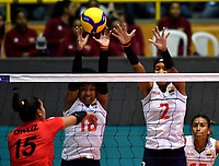 BOGOTÁ-COLOMBIA, 08-01-2020: Margarita Martínez y Yeisy Soto de Colombia, intentan un bloqueo al ataque de balón a Karla Ortiz de Perú, durante partido entre Perú y Colombia en el Preolímpico Suramericano de Voleibol, clasificatorio a los Juegos Olímpicos Tokio 2020, jugado en el Coliseo del Salitre en la ciudad de Bogotá del 7 al 9 de enero de 2020. / Maria Marin y Yeisy Soto from Colombia, trie to block the attack the ball to Karla Ortiz from Peru, during a match between Peru and Colombia, in the South American Volleyball Pre-Olympic Championship, qualifier for the Tokyo 2020 Olympic Games, played in the Colosseum El Salitre in Bogota city, from January 7 to 9, 2020. Photo: VizzorImage / Luis Ramírez / Staff.