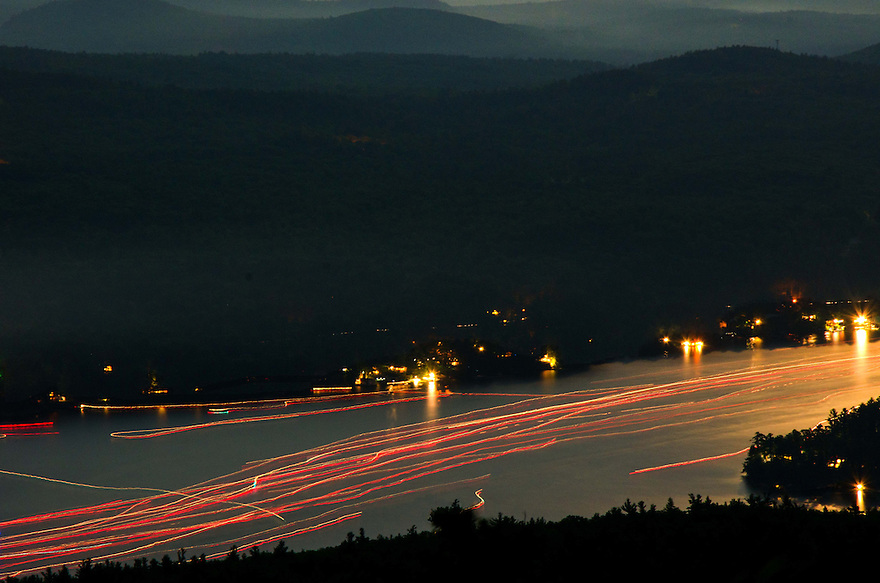 The Fourth of July fireworks in the town of Alton NH can be seen from above by those who venture to the summit of Mt. Major. This year I joined the surprising number of viewers taking in not only the fireworks display, but also a so-called 'supermoon'. Long after most folks left the summit, I made this image of boat traffic as it flowed in an electric river back into the lake.