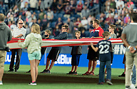 FOXBOROUGH, MA - SEPTEMBER 11: American flag unfurled on the Gillette Stadium turf held by representatives from USO New England, the Wounded Warrior Project, and Tuesday's Children before a game between New York City FC and New England Revolution at Gillette Stadium on September 11, 2021 in Foxborough, Massachusetts.