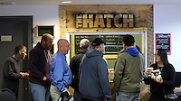 Pictured: People get served food and hot drinks Tuesday 29 November 2016<br /> Re: Soup kitchen for homeless people organised by Swansea City FC and Woolwich at the Liberty Stadium, Wales, UK