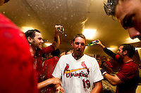 Deryk Hooker (19) of the Springfield Cardinals has non-alcholic champagne poured on his head by teammate Michael Blazek (33) as they celebrate in the clubhouse after beating the Tulsa Drillers in the North Division Championship game at Hammons Field on September 9, 2012 in Springfield, Missouri. (David Welker/Four Seam Images)