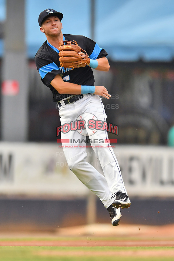 Asheville Tourists third baseman Matt McLaughlin (5) throws to first base during a game against the Rome Braves at McCormick Field on September 2, 2018 in Asheville, North Carolina. The Braves defeated the Tourists 2-1. (Tony Farlow/Four Seam Images)