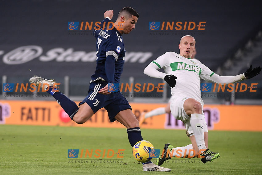 Cristiano Ronaldo of Juventus FC and Vlad Chiriches of US Sassuolo compete for the ball during the Serie A football match between Juventus FC and US Sassuolo Calcio at Allianz stadium in Torino (Italy), January 10th, 2021. Photo Federico Tardito / Insidefoto