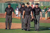 MiLB umpires Andrew Barrett, Joe Gonzalez, Darius Ghani, Luis Hernandez take the field prior to the 2018 California League All-Star Game at The Hangar on June 19, 2018 in Lancaster, California. The North All-Stars defeated the South All-Stars 8-1.  (Donn Parris/Four Seam Images)