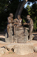 """The Philosophers' Rock Statue at Barton Springs Pool, CAST's first project, installed in 1994, is a larger-than-lifesize bronze sculpture of three renowned Austin writers that sits under a pecan grove at the entrance to Barton Springs Pool. J. Frank Dobie, Roy Bedichek, and Walter Prescott Webb used to meet at Barton Springs every afternoon and hold forth in what has been characterized as """"Austin's first literary salon."""" The men met on a rock at the edge of the pool that Bedichek dubbed """"Philosophers' Rock."""" The statue, by renowned sculptor Glenna Goodacre (who created the Women in Vietnam memorial in Washington D.C. and the image of Sacajawea on the new dollar coin) is an unforgettable depiction of three good friends engaged in an informal but intense discussion. A monument to friendship, ideas, the glory of nature and the joy of conversation, Philosophers' Rock quickly became a beloved Austin landmark. The Austin Chronicle, in naming Philosophers' Rock the """"Best Public Art"""" in Austin, wrote: """"It does what great statues do: recognize achievement, convey a sense of the community from which it sprang, and inspire us."""" The Austin American Statesman declared it """"an irresistable connection to Texas' literary past."""""""