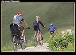 France, Chamonix.  <br /> Digital cameras allow you to take many images for free, so you can get lucky sometimes.  Family cycling at Le Tour, above Chamonix.