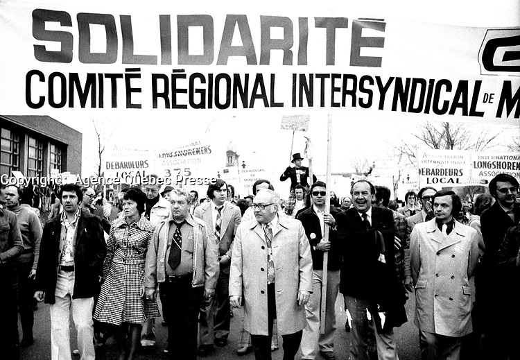 May 1st, 1975 File Photo - Union leaders Louis Laberge , Yvon Charbonneau and marcel Pepin walk in May 1st- workers day parade in Montreal