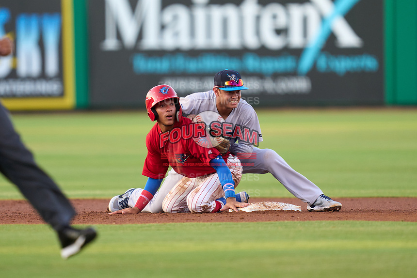 Tampa Tarpons second baseman Jesus Bastidas (14) and Yhoswar Garcia (9) watch the end of a double play during a game against the Clearwater Threshers on June 10, 2021 at BayCare Ballpark in Clearwater, Florida.  (Mike Janes/Four Seam Images)