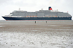 Cunard Line's Three Queens Meeting Liverpool. <br /> Crosby Beach 25.5.15.  Queen Victoria viewed from Crosby Beach on her  way into Liverpool.