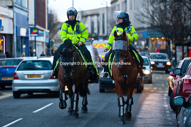 Thursday 20 February 2014<br /> Pictured: Police horses make their way up Swansea High Street<br /> Re: Napoli Supporters visit Swansea for tonights UEFA Leauge clash