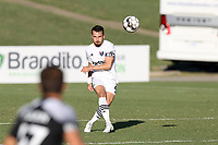 RICHMOND, VA - SEPTEMBER 30: Alex Comsia #4 of North Carolina FC kicks the ball up the field during a game between North Carolina FC and New York Red Bulls II at City Stadium on September 30, 2020 in Richmond, Virginia.