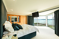 BNPS.co.uk (01202) 558833. <br /> Pic: TailorMade/AshleyFaull/BNPS<br /> <br /> Pictured: The master bedroom of the £6m mansion which has now been demolished. <br /> <br /> A wealthy homeowner has made the 'brave' decision to demolish his £6m seaside mansion that has its own indoor pool, gym and cinema. <br /> <br /> Ashley Faull has flattened the 20-year-old luxury house to build nine new flats to meet the increasing demand for housing that has led to a surge in property prices.<br /> <br /> The apartments will be priced between £1.495m to £2.8m.<br /> <br /> The now ruined four-storey and 19-room home sits on a half-an-acre plot that backs on to Poole Harbour and overlooks exclusive Sandbanks in Dorset.