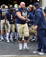 Justin Virbitsky and Paul Chryst shake hands on Senior Day. The Pitt Panthers defeat the Rutgers Scarlet Knights 27-6 on Saturday, November 24, 2012 at Heinz Field , Pittsburgh, PA.