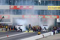 May 18, 2018; Topeka, KS, USA; NHRA top fuel driver Billy Torrence (left) alongside son Steve Torrence during qualifying for the Heartland Nationals at Heartland Motorsports Park. Mandatory Credit: Mark J. Rebilas-USA TODAY Sports