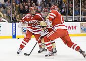 Garrett Noonan (BU - 13), Pat Mullane (BC - 11), Patrick MacGregor (BU - 4) - The Boston College Eagles defeated the Boston University Terriers 3-2 (OT) to win the 2012 Beanpot championship on Monday, February 13, 2012, at TD Garden in Boston, Massachusetts.