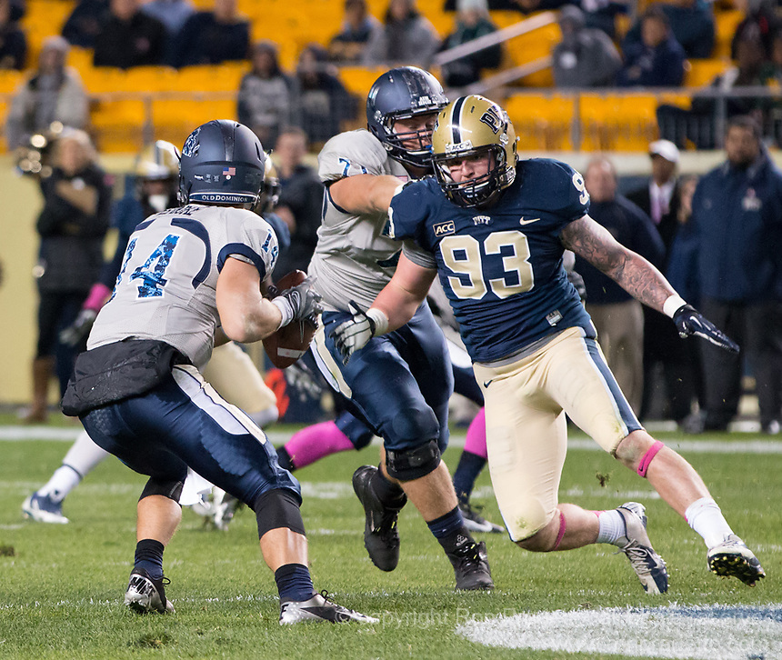 Pitt defensive lineman Bryan Murphy (93) rushes the quarterback. The Pitt Panthers defeated the Old Dominion Monarchs 35-24 at Heinz Field, Pittsburgh, Pennsylvania on October 19, 2013.