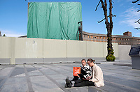 """Lena Margrethe Hoen Berge and Karsten Lunde hold a sit down protest. Y-block, the former government building contains work of Picasso and Nesjar and the planned demolition is very unpopular.<br /> <br /> In the late 1950s and the early 1970s the Spanish artist Pablo Picasso designed five murals (The Beach, The Seagull, Satyr and Faun and two versions of The Fisherman) for the Regjeringskvartalet ('Government quarter') buildings in central Oslo, Norway.<br /> <br /> The designs by Picasso were executed in concrete by Norwegian artist Carl Nesjar, and were Picasso's first attempt at monumental concrete murals<br /> <br /> The modernist building, the Y-block, which formed part of the Norwegian government quarter for over fifty years. <br /> <br /> The building was drawn by architect Erling Viksjø and was finished 1969. Following the 2011 terror attack the building was left empty while the government have been mulling its' options. <br /> <br /> A decision on the fate of the murals was expected in early 2014. The murals were subsequently listed as one of Europe's most endangered heritage sites in 2015 by the heritage organisation Europa Nostra following the Norwegian cabinet's vote to demolish the Y-block building.<br /> <br /> In the beginning of 2020 the Norwegian government decided to tear down the building and redevelop the goverment quarter. <br /> <br /> The Architect's Newspaper writes: <br /> """"Demolition-ready government officials have vowed to save and relocate the murals, which were executed by Picasso's frequent collaborator, the Norwegian artist Carl Nesjar. Preservationists near and far, however, are crying foul. They believe that the building itself should also be spared from the wrecking ball.""""<br /> <br /> <br /> ©Fredrik Naumann/Felix Features"""