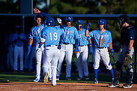 AZL Royals Edickson Soto (19) is congratulated by Gary Camarillo (16), Diego Maican (13), Omar Hernandez (12), and Jimmy Govern (8) after hitting a grand slam during an Arizona League game against the AZL Brewers Blue at Surprise Stadium on June 18, 2019 in Surprise, Arizona. AZL Royals defeated AZL Brewers Blue 12-7. (Zachary Lucy/Four Seam Images)