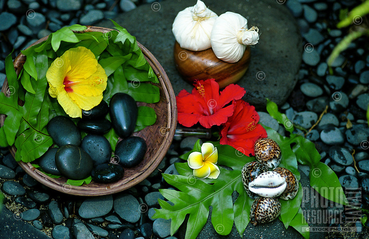 Still life of assorted items used for treatments at the Mauna Lani spa-Pohaku stones, Thai herbal pouches & shells